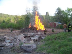 Monticello Fire Dept with controlled fire